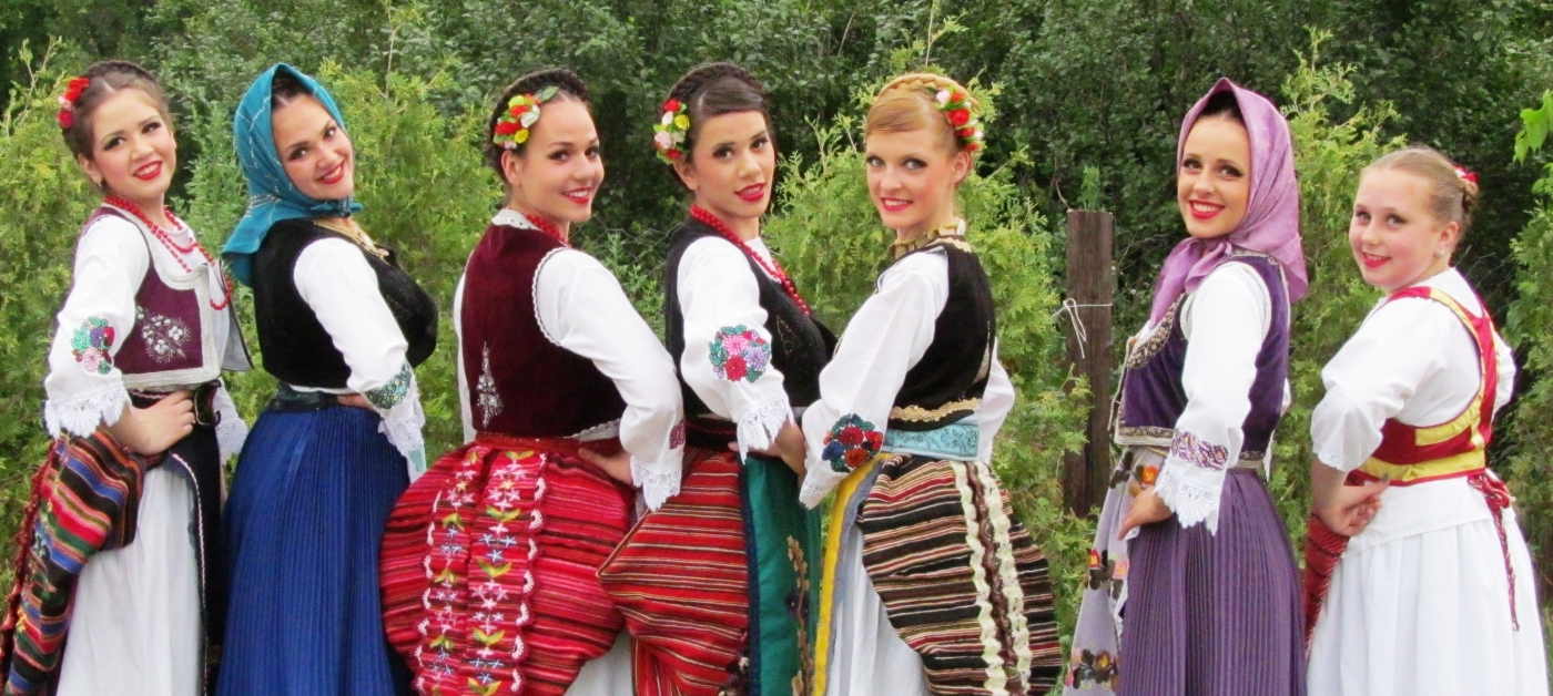 Girls in traditional costume from around Belgrade and one from Backa