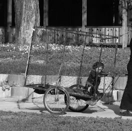 """A Roma woman heading to """"work """"with her child."""